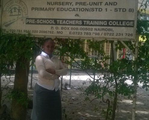 Clares standing in front of her new school
